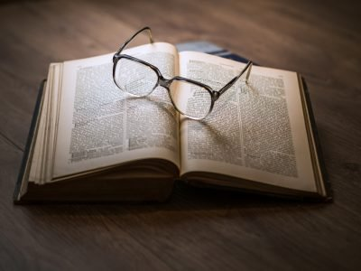 Book with glasses resting on top